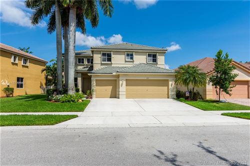 Photo of 807 Sunflower Cir, Weston, FL 33327 (MLS # A10702643)