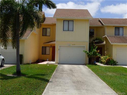 Photo of 1573 Woodbridge Lakes Cir, West Palm Beach, FL 33406 (MLS # A10836644)