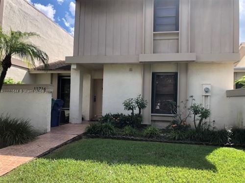 Photo of 11716 SW 91st Ter #11716, Miami, FL 33186 (MLS # A11111644)