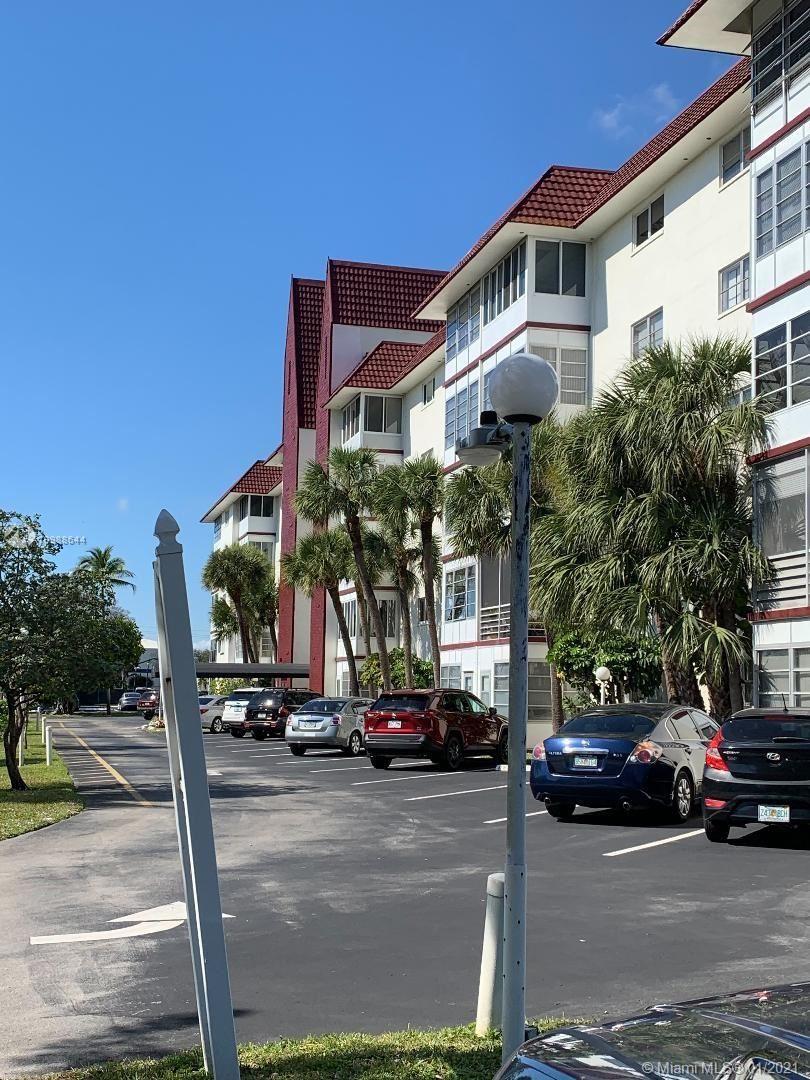 Photo of 4851 NW 21st St #301, Lauderhill, FL 33313 (MLS # A10988644)