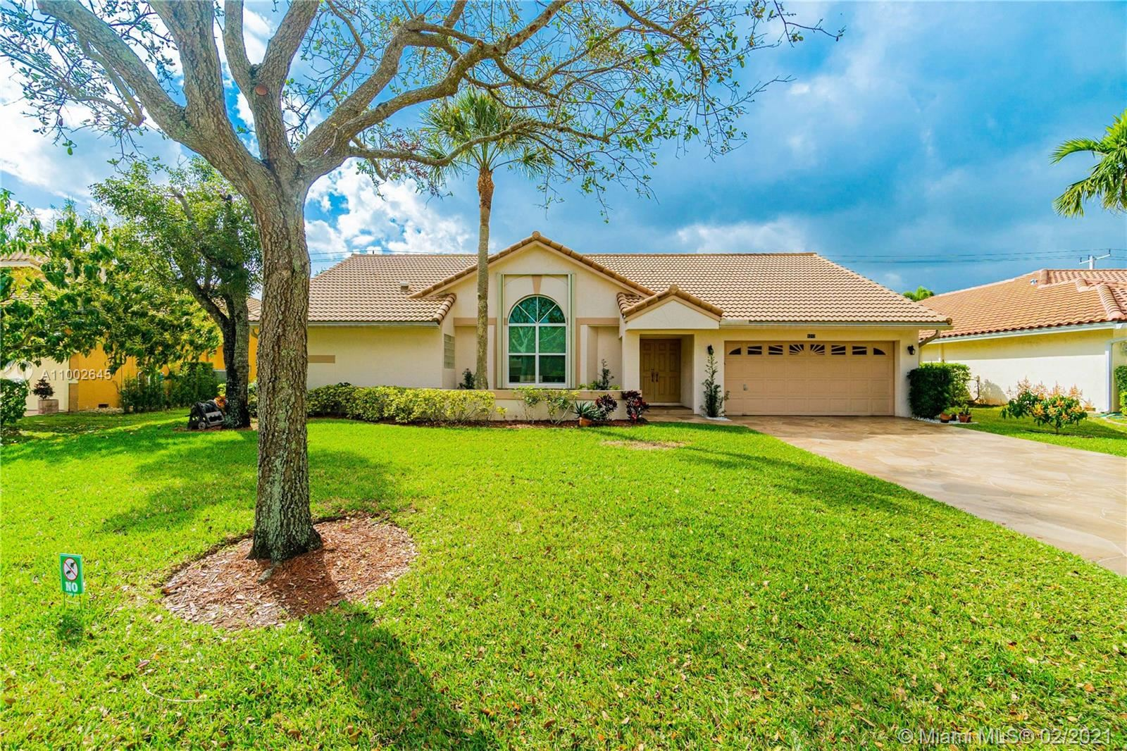 Photo of 8212 NW 40th Ct, Coral Springs, FL 33065 (MLS # A11002645)