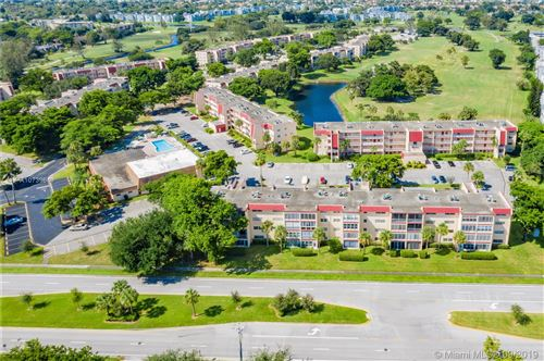 Photo of 1000 Country Club Dr #406, Margate, FL 33063 (MLS # A10739649)