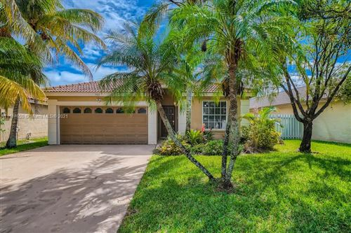 Photo of 701 NW 182nd Way, Pembroke Pines, FL 33029 (MLS # A11117650)
