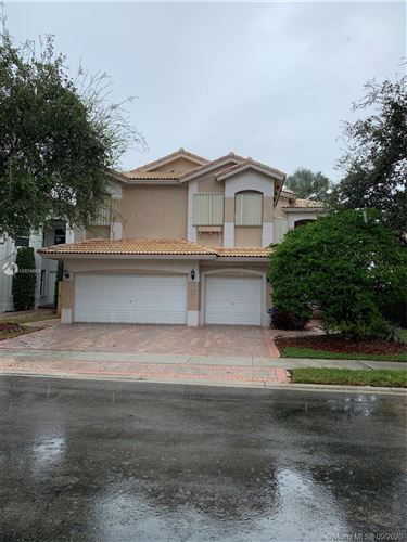 Photo of 6957 NW 107th Ct, Doral, FL 33178 (MLS # A10924653)