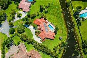 Photo of 4400 NW 100th Ave, Coral Springs, FL 33065 (MLS # A10713655)