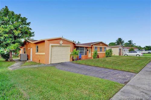 Photo of 4961 NW 17th Ct, Lauderhill, FL 33313 (MLS # A11099656)
