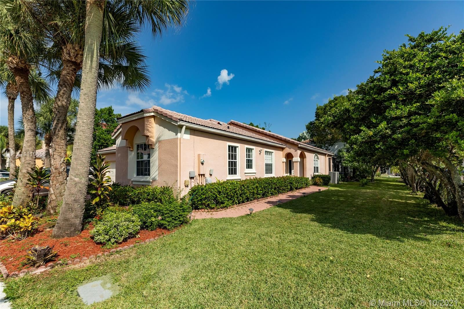 Photo of 601 NW 156th Ave, Pembroke Pines, FL 33028 (MLS # A11110656)