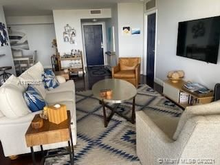 Photo of 2000 Towerside Ter #1205, Miami, FL 33138 (MLS # A11025657)