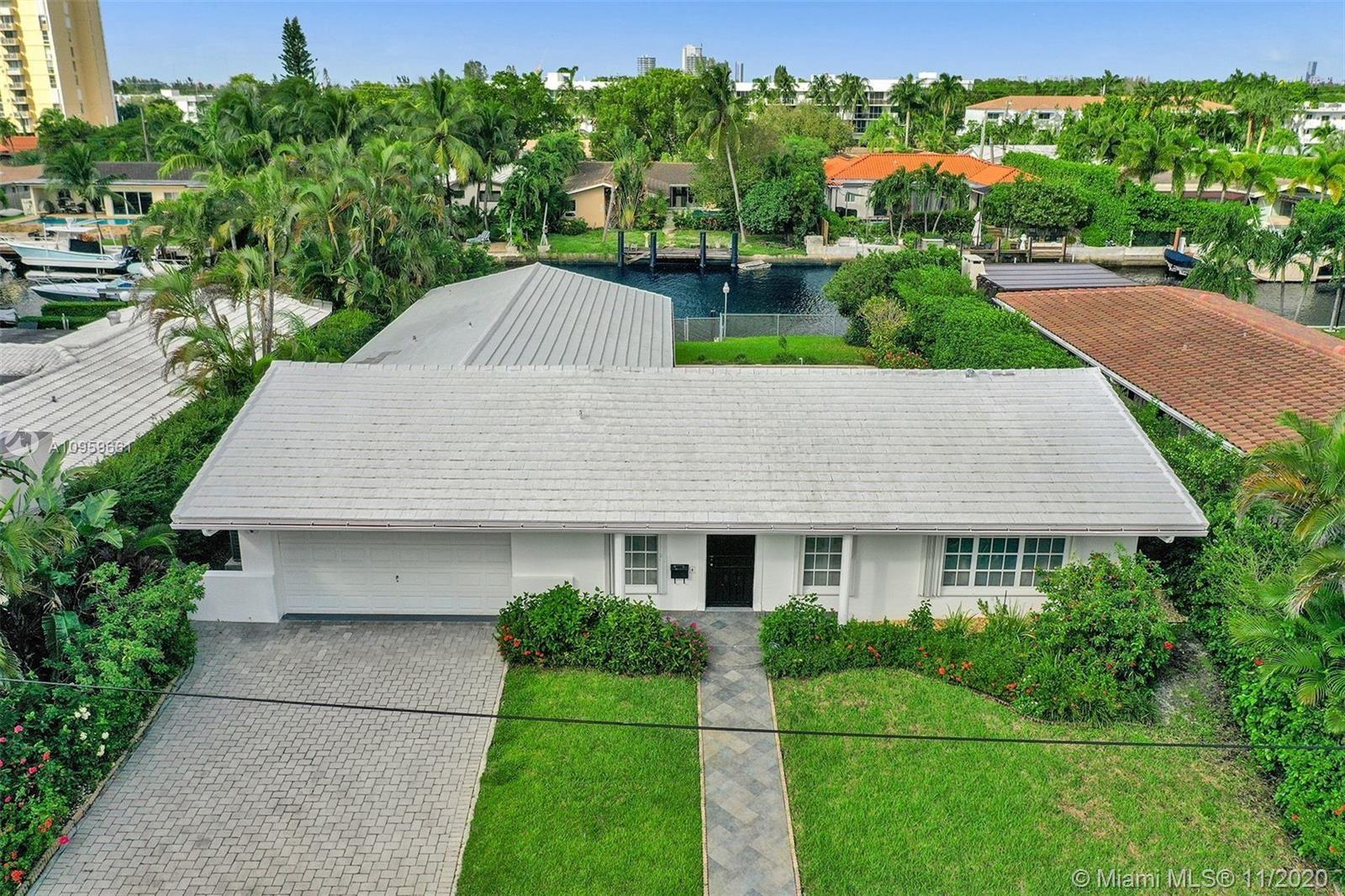 Photo of 2345 Magnolia Dr, North Miami, FL 33181 (MLS # A10959661)