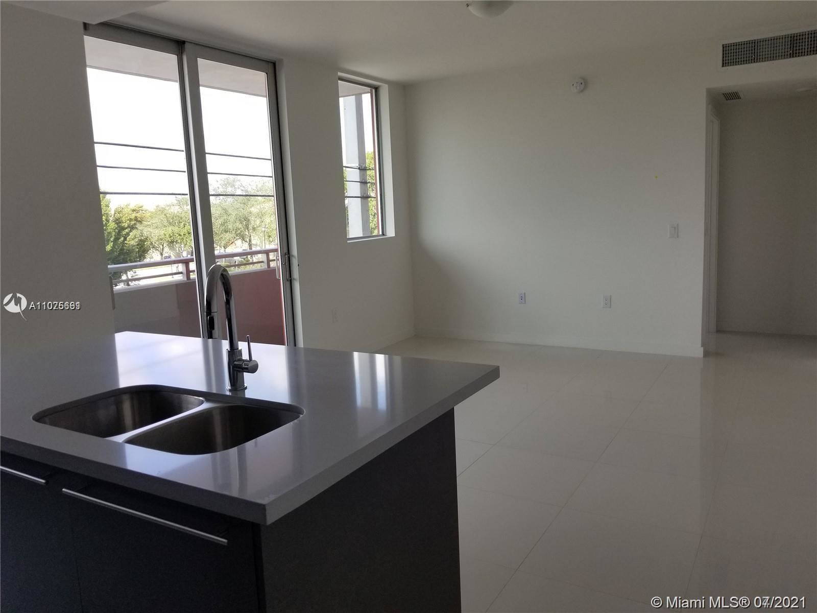 Photo of 7875 NW 107th Ave #218, Doral, FL 33178 (MLS # A11075661)