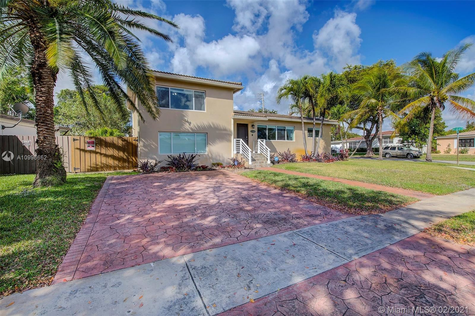 Photo of 12300 NE Miami Ct, North Miami, FL 33161 (MLS # A10996662)