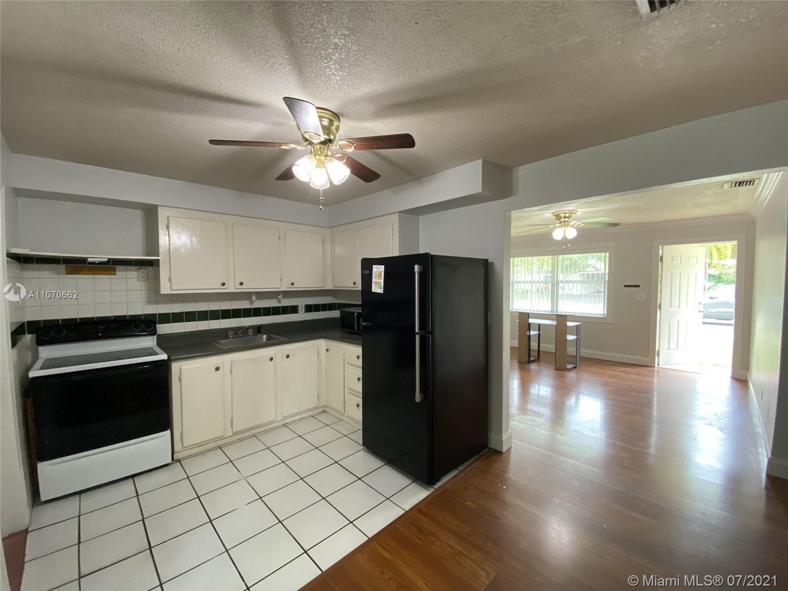 Photo of 9469 SW 52nd Ct #9469, Cooper City, FL 33328 (MLS # A11070662)