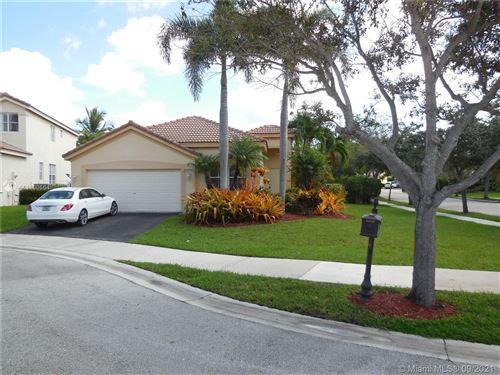 Photo of 1520 Tamarind Ct, Weston, FL 33327 (MLS # A11100664)