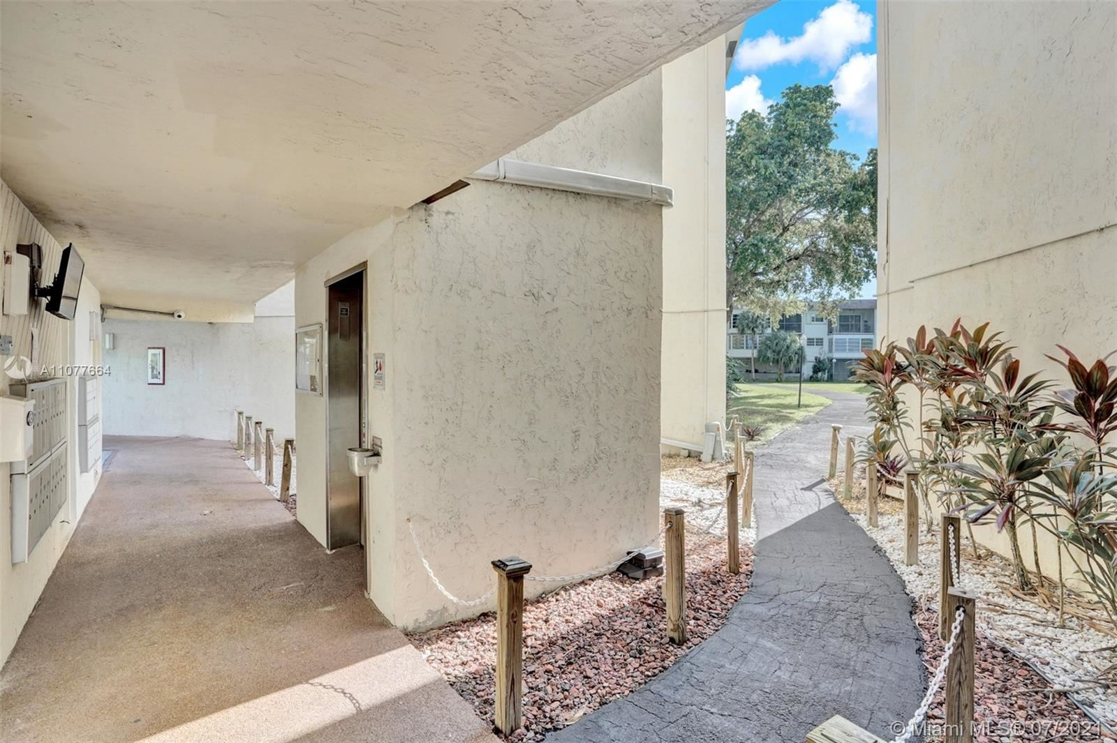 Photo of 1801 NW 75th Ave #209, Plantation, FL 33313 (MLS # A11077664)