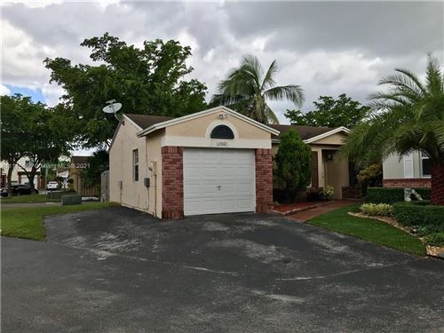 Photo of 19321 NW 83rd Ave, Hialeah, FL 33015 (MLS # A11115665)