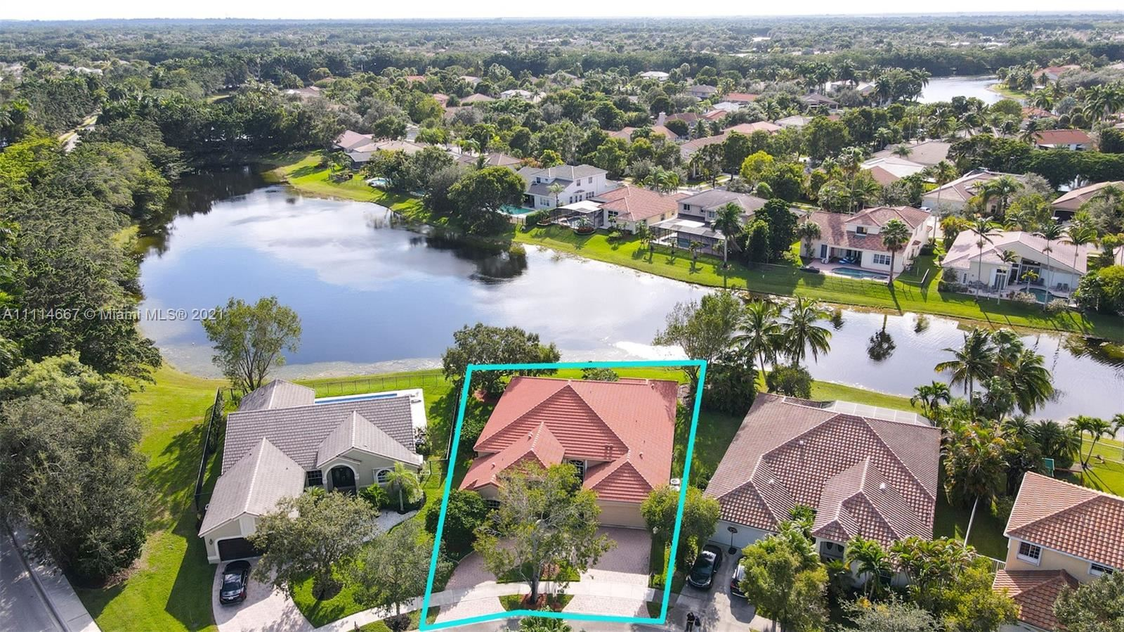 Photo of 607 Lake Blvd, Weston, FL 33326 (MLS # A11114667)
