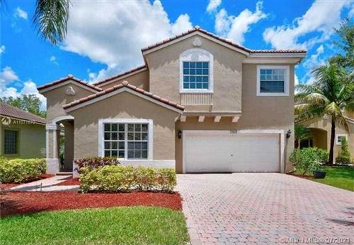 Photo of 12629 NW 6th Ct, Coral Springs, FL 33071 (MLS # A11077670)