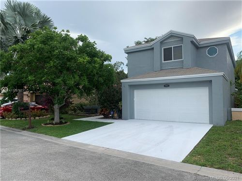 Photo of 1961 NW 35th Ter, Coconut Creek, FL 33066 (MLS # A11057671)