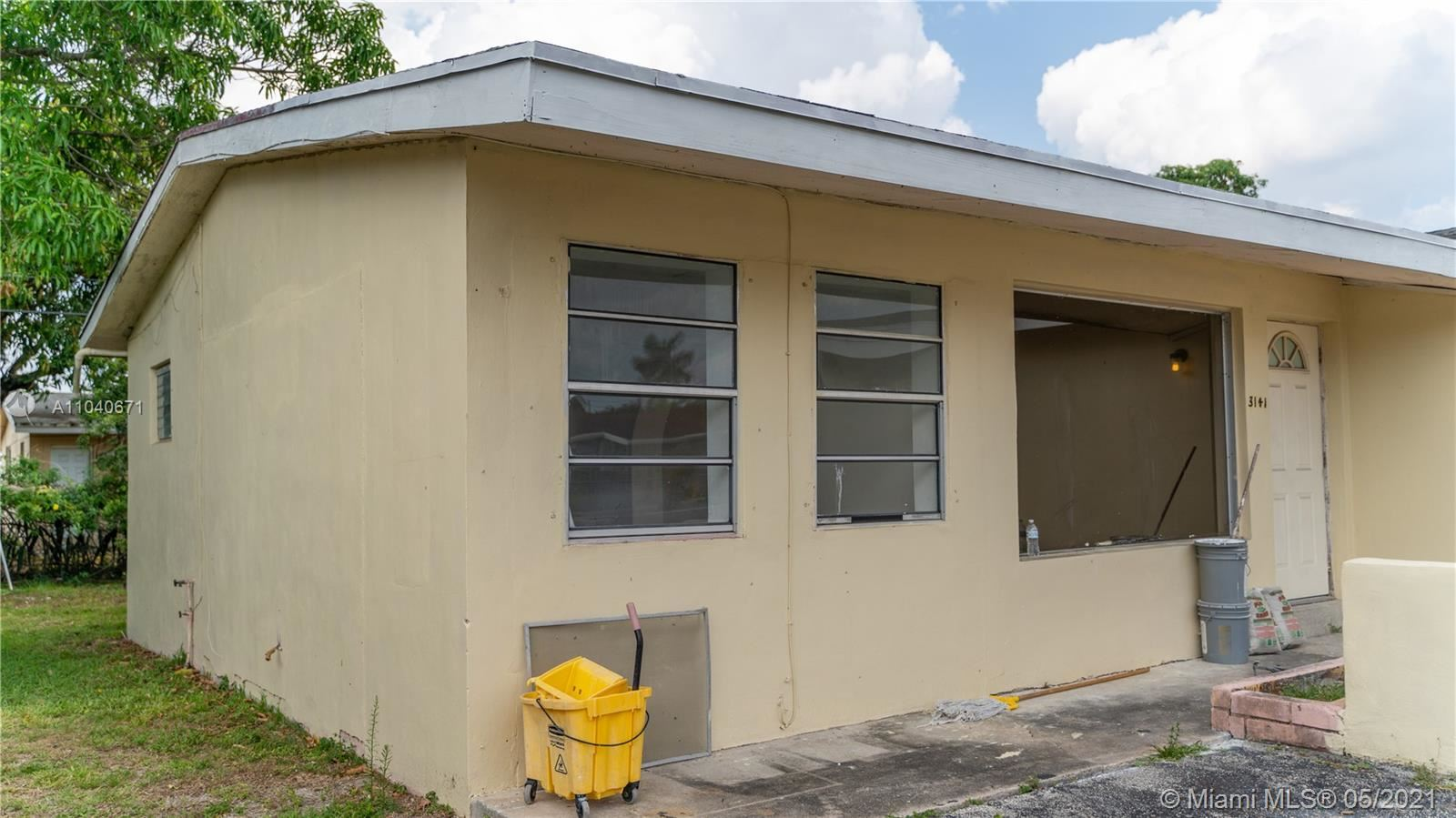 Photo of 3141 NW 4th Ct, Lauderhill, FL 33311 (MLS # A11040671)
