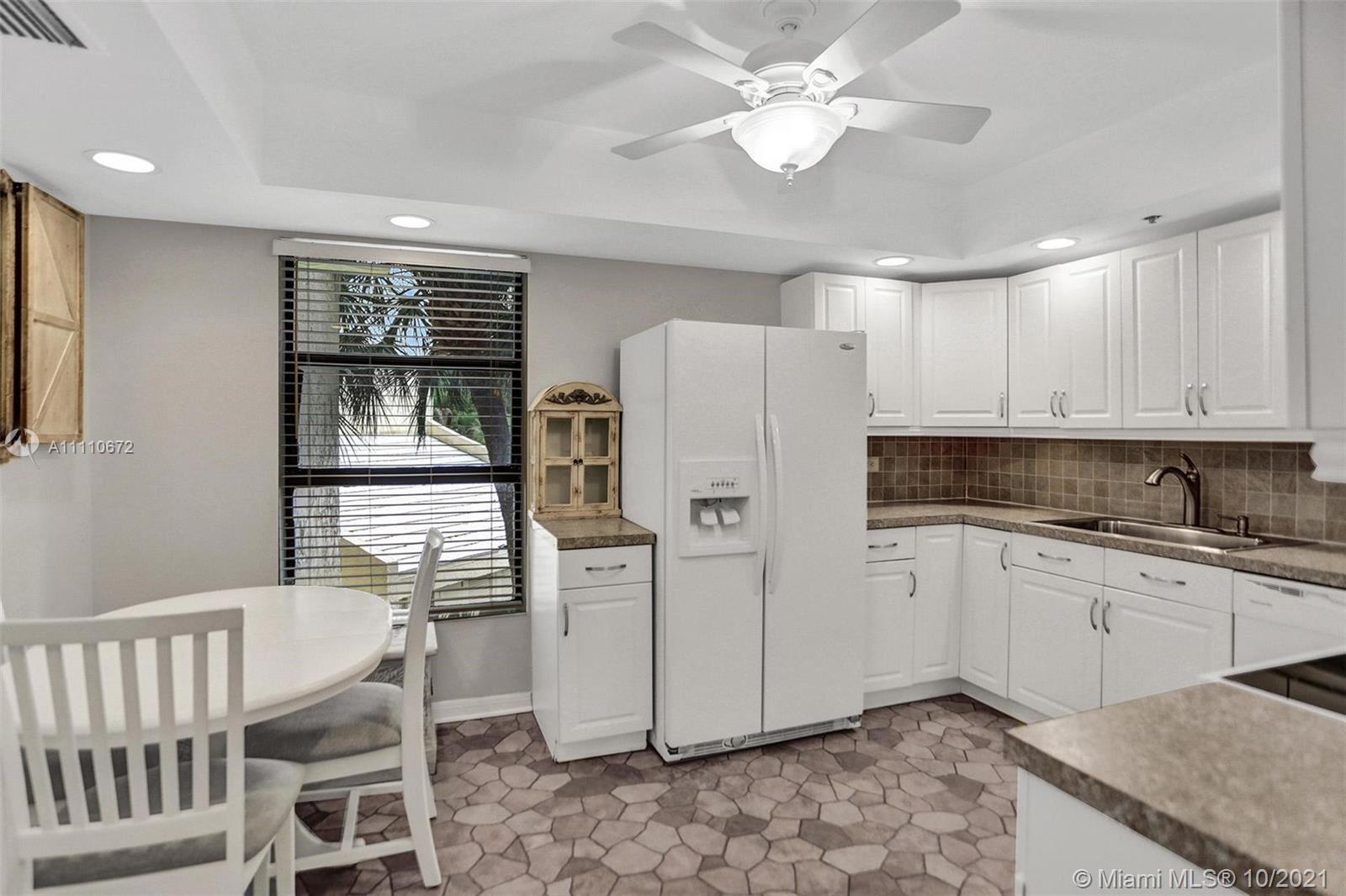 Photo of 7400 Radice Ct #201, Lauderhill, FL 33319 (MLS # A11110672)