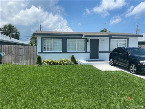 Photo of 515 NW 11th Ave, Boynton Beach, FL 33435 (MLS # A11079673)