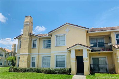 Photo of 1211 Belmont Ln #1211, North Lauderdale, FL 33068 (MLS # A10872674)