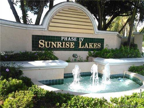 Photo of 10220 NW 30th Ct #208, Sunrise, FL 33322 (MLS # A11042675)