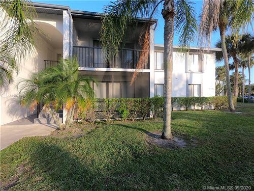 Photo of 1006 Green Pine Blvd #H1, West Palm Beach, FL 33409 (MLS # A10878676)