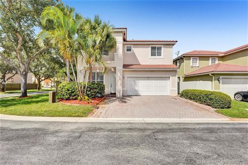 Photo of 7699 NW 19th St, Pembroke Pines, FL 33024 (MLS # A11098676)