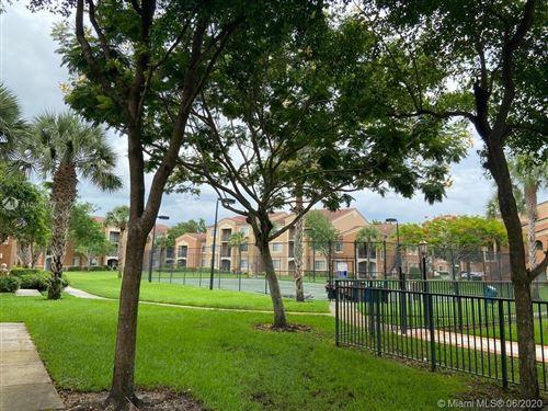 Photo of 7920 N Nob Hill Rd #304, Tamarac, FL 33321 (MLS # A10881677)