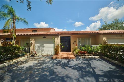 Photo of 14730 Breckness Pl #14730, Miami Lakes, FL 33016 (MLS # A10885677)