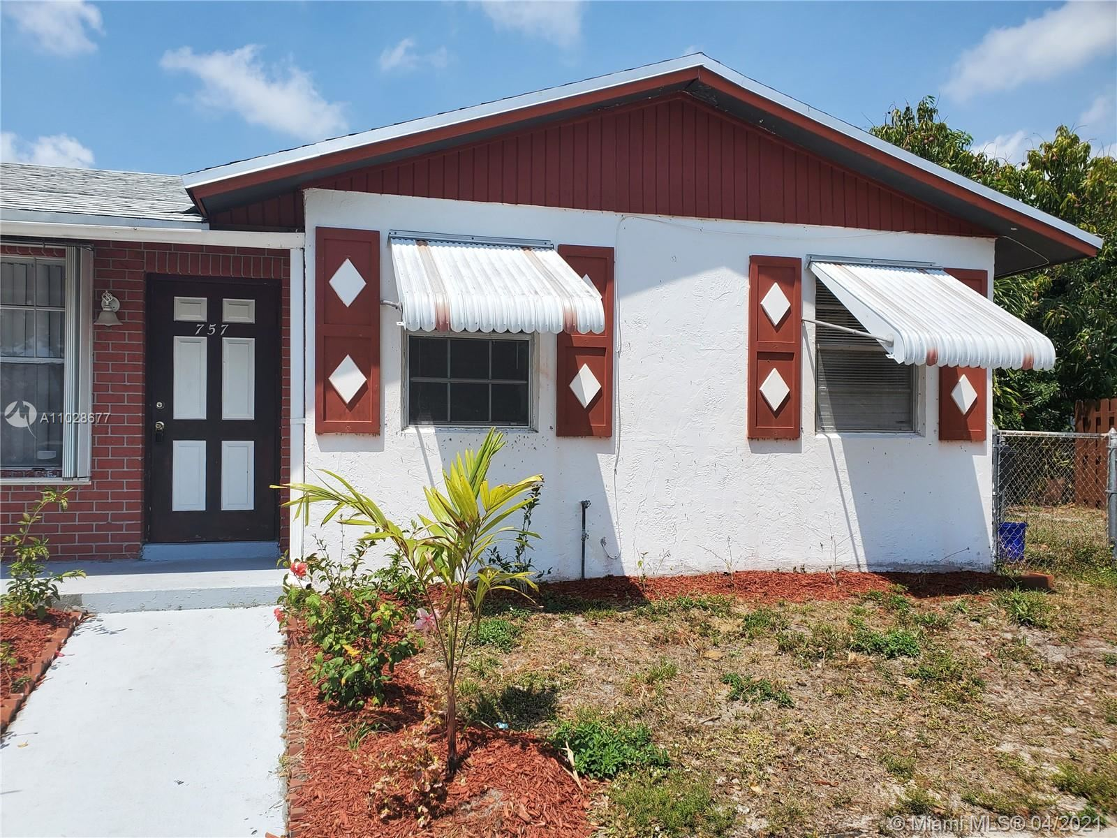 Photo of 757 W Ilene Rd W #1, West Palm Beach, FL 33415 (MLS # A11028677)