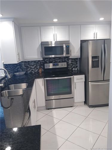 Photo of 408 NW 68th Ave #312, Plantation, FL 33317 (MLS # A10757678)