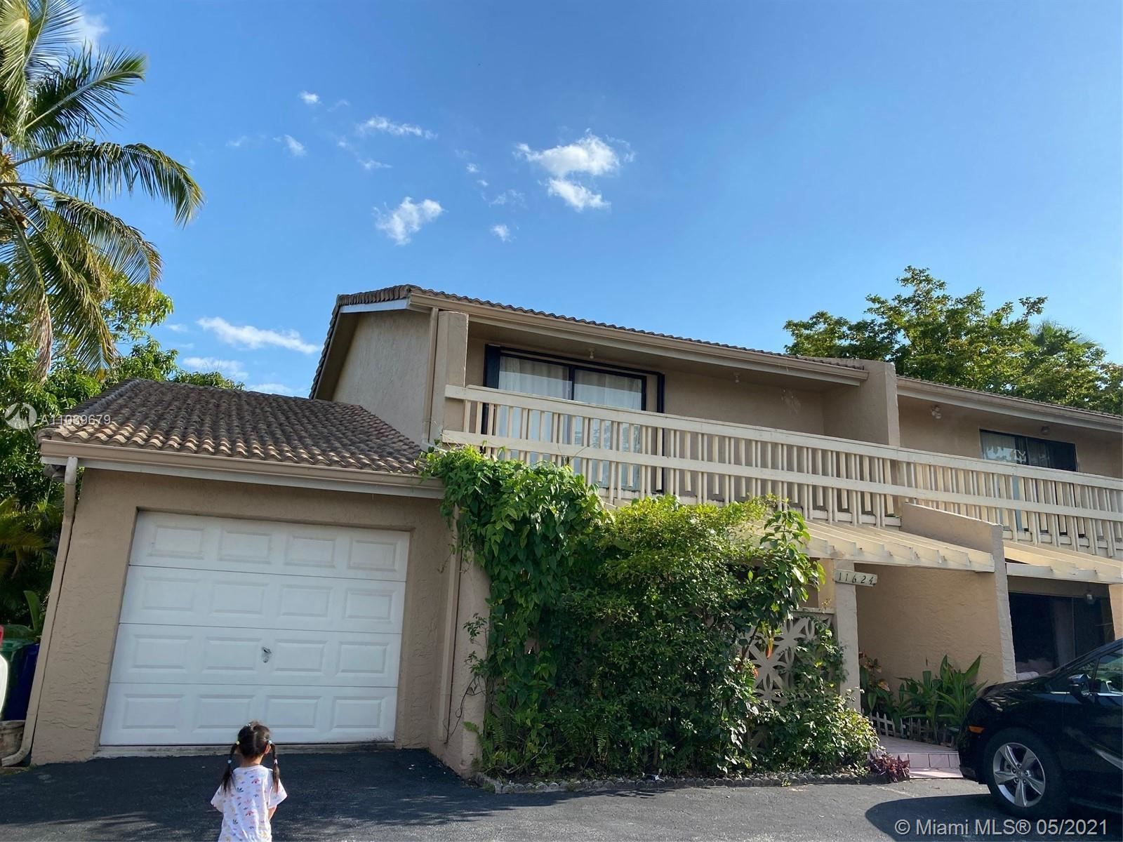 Photo of 11624 NW 30th St #1E, Coral Springs, FL 33065 (MLS # A11039679)