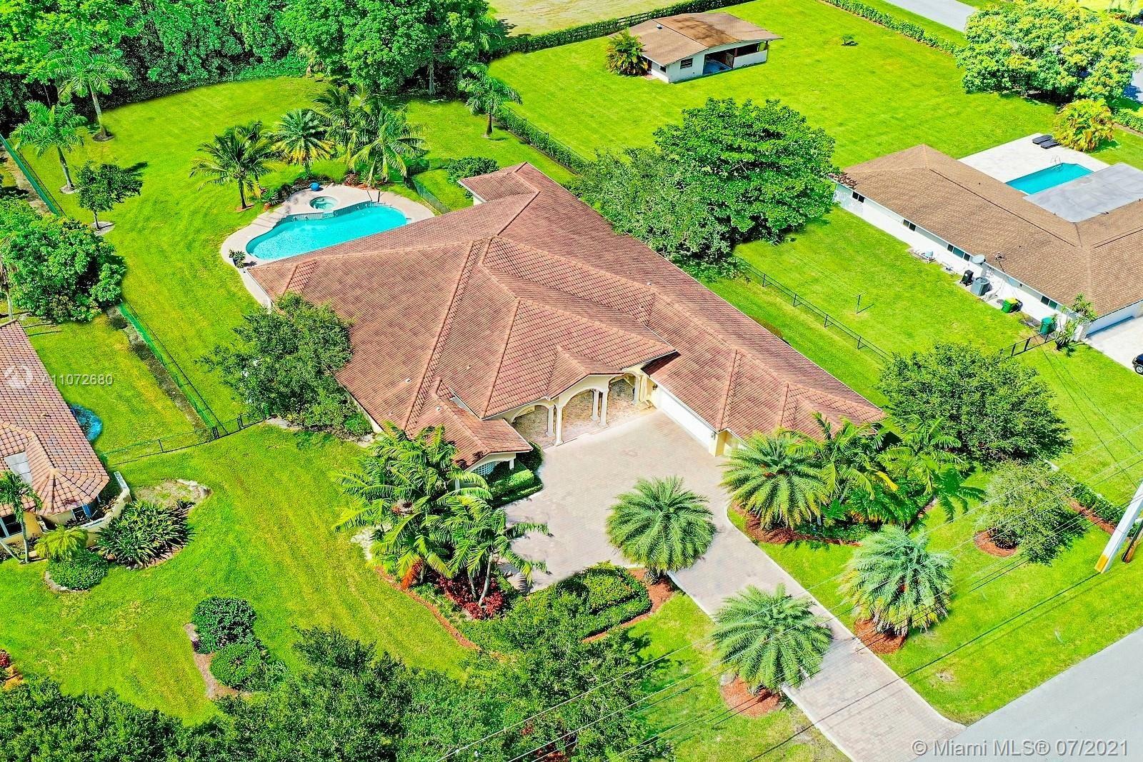 Photo of 12231 NW 12th St, Plantation, FL 33323 (MLS # A11072680)