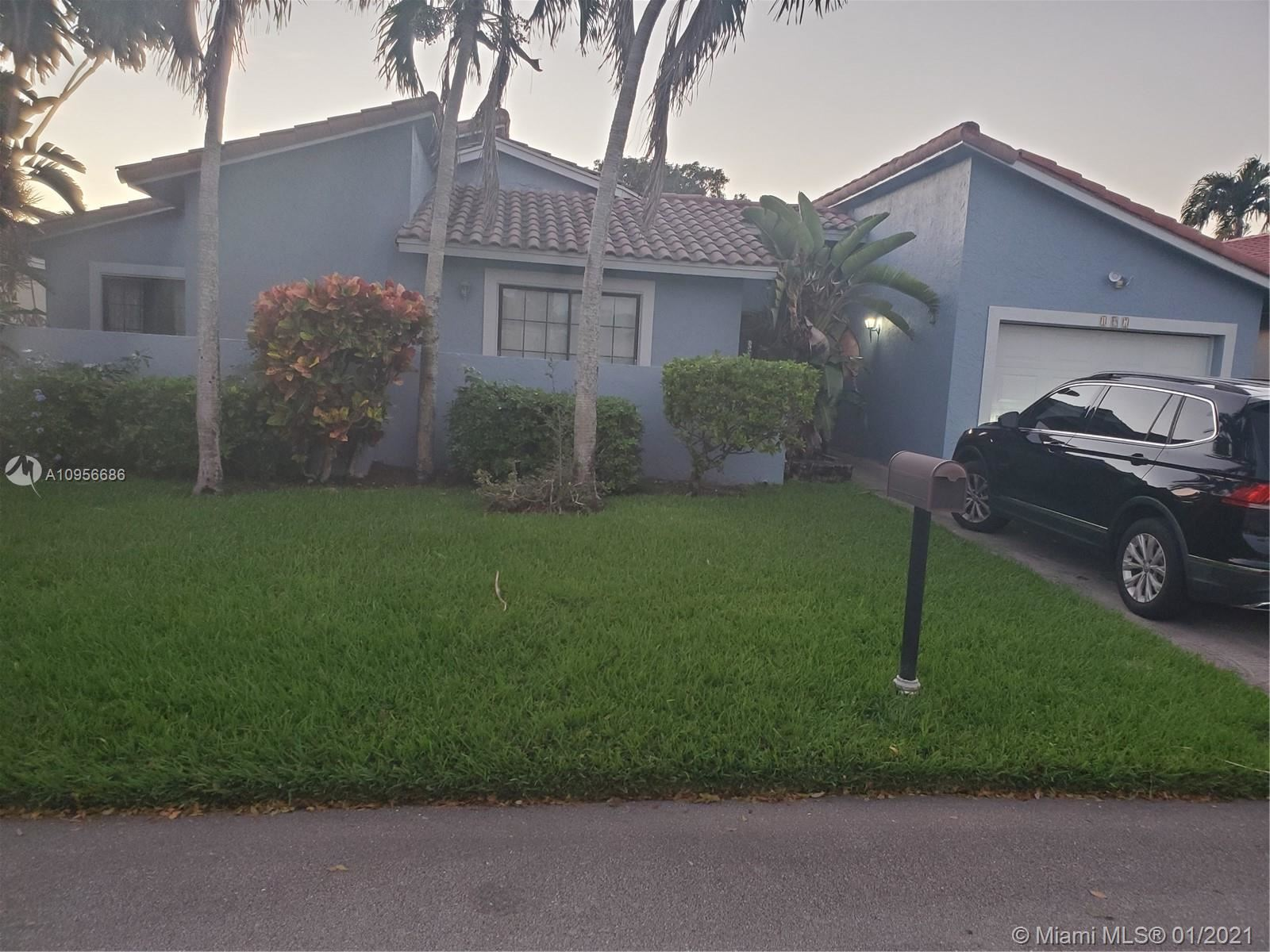 Photo of 197 NW 47th Ave, Deerfield Beach, FL 33442 (MLS # A10956686)