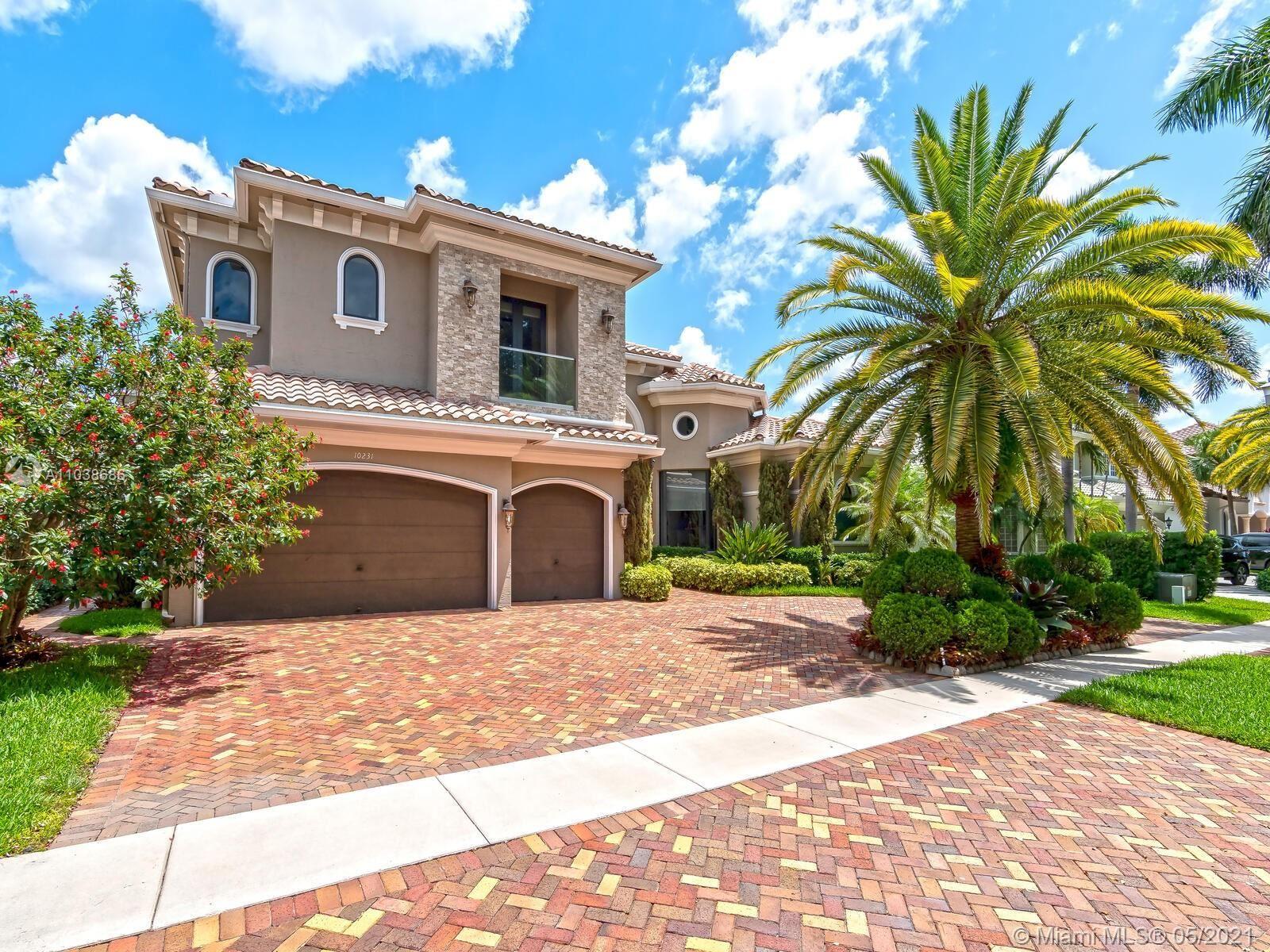 Photo of 10231 Blue Palm St, Plantation, FL 33324 (MLS # A11038686)