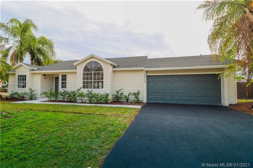 Photo of 14814 SW 152nd Ter, Miami, FL 33187 (MLS # A10952687)