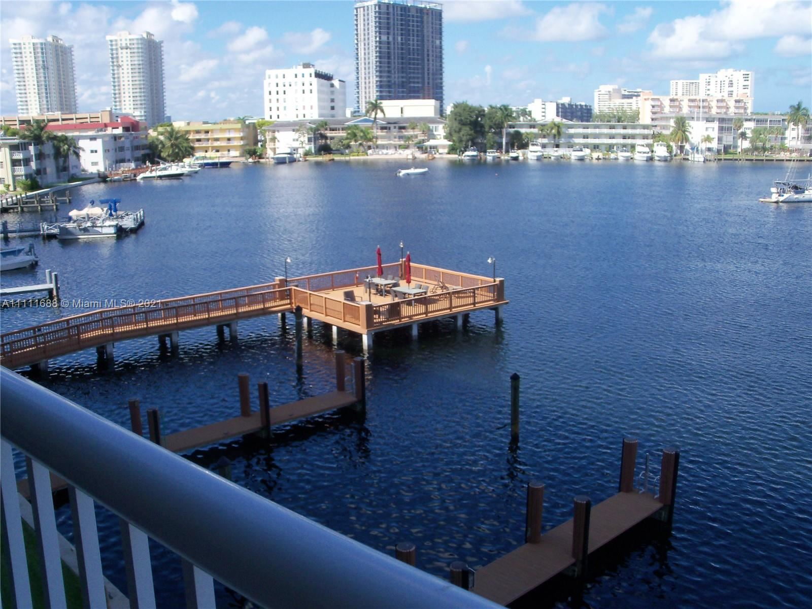 Photo of 410 Golden Isles Dr #406, Hallandale Beach, FL 33009 (MLS # A11111688)