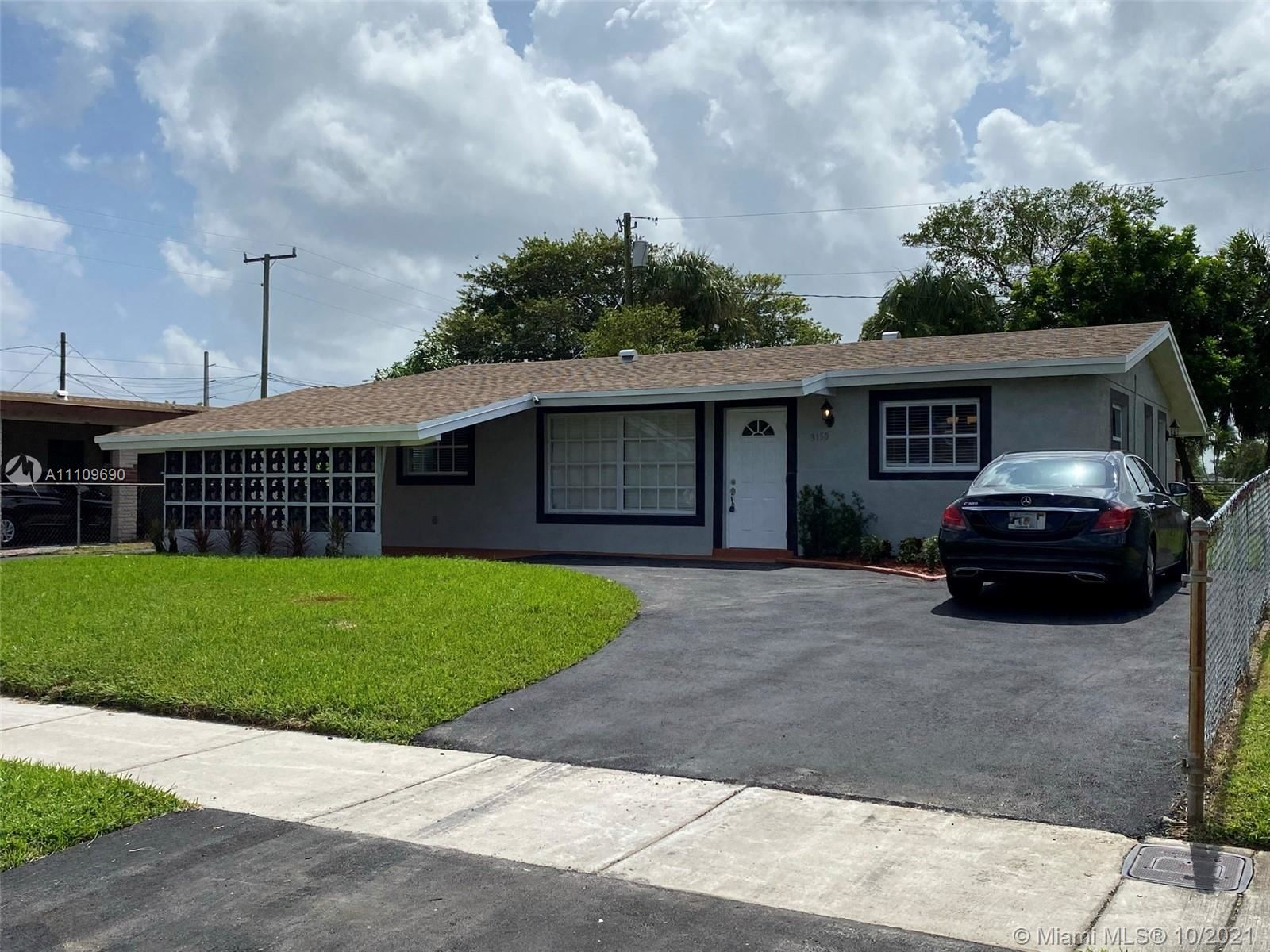 Photo of 3150 NW 14th St, Lauderhill, FL 33311 (MLS # A11109690)