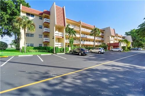 Photo of 1030 Country Club Dr #103, Margate, FL 33063 (MLS # A11110691)