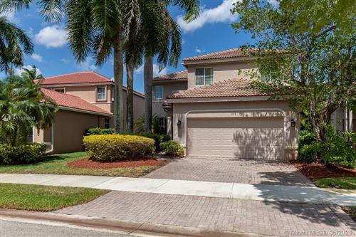 Photo of 1078 Bluewood Ter, Weston, FL 33327 (MLS # A11038693)