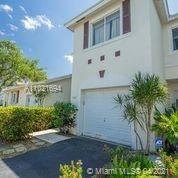 Photo of 774 NW 42nd Pl, Deerfield Beach, FL 33064 (MLS # A11021694)