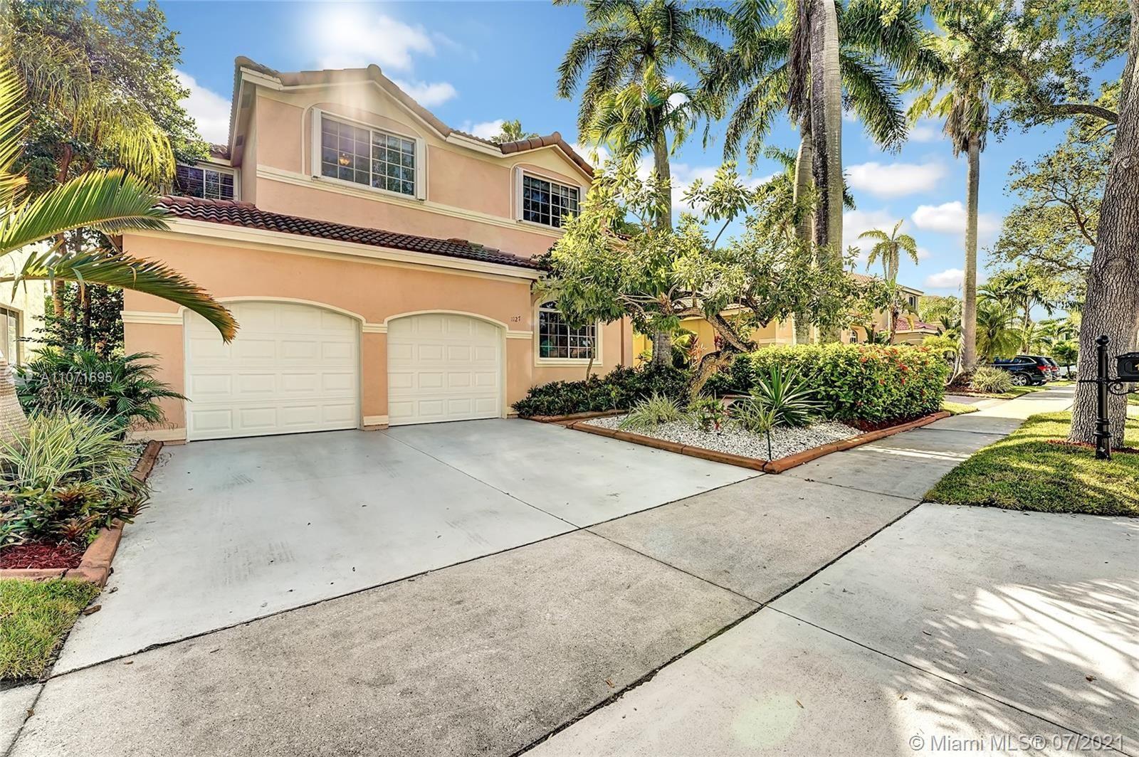 Photo of 1127 Camellia Cir, Weston, FL 33326 (MLS # A11071695)