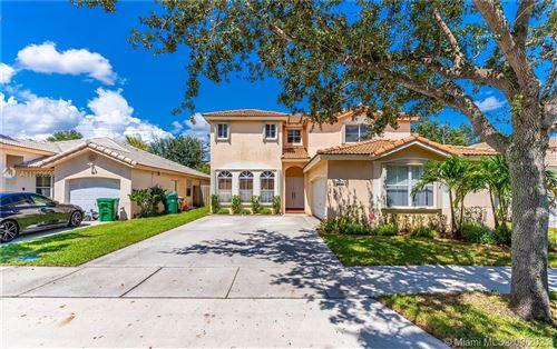 Photo of 13771 N Garden Cove Cir, Davie, FL 33325 (MLS # A11100698)