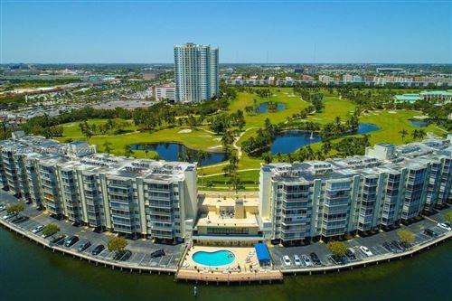 Photo of 300 Diplomat Pkwy #205, Hallandale Beach, FL 33009 (MLS # A11056700)