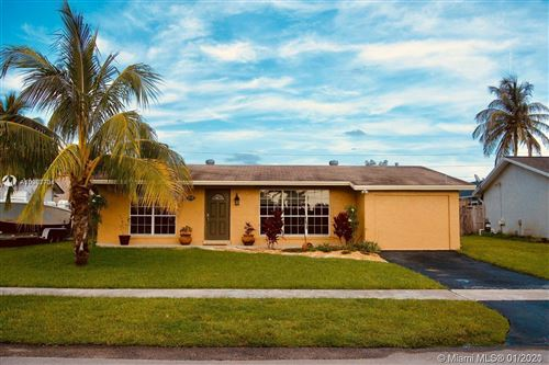 Photo of 3570 NW 113th Ave, Sunrise, FL 33323 (MLS # A10987701)