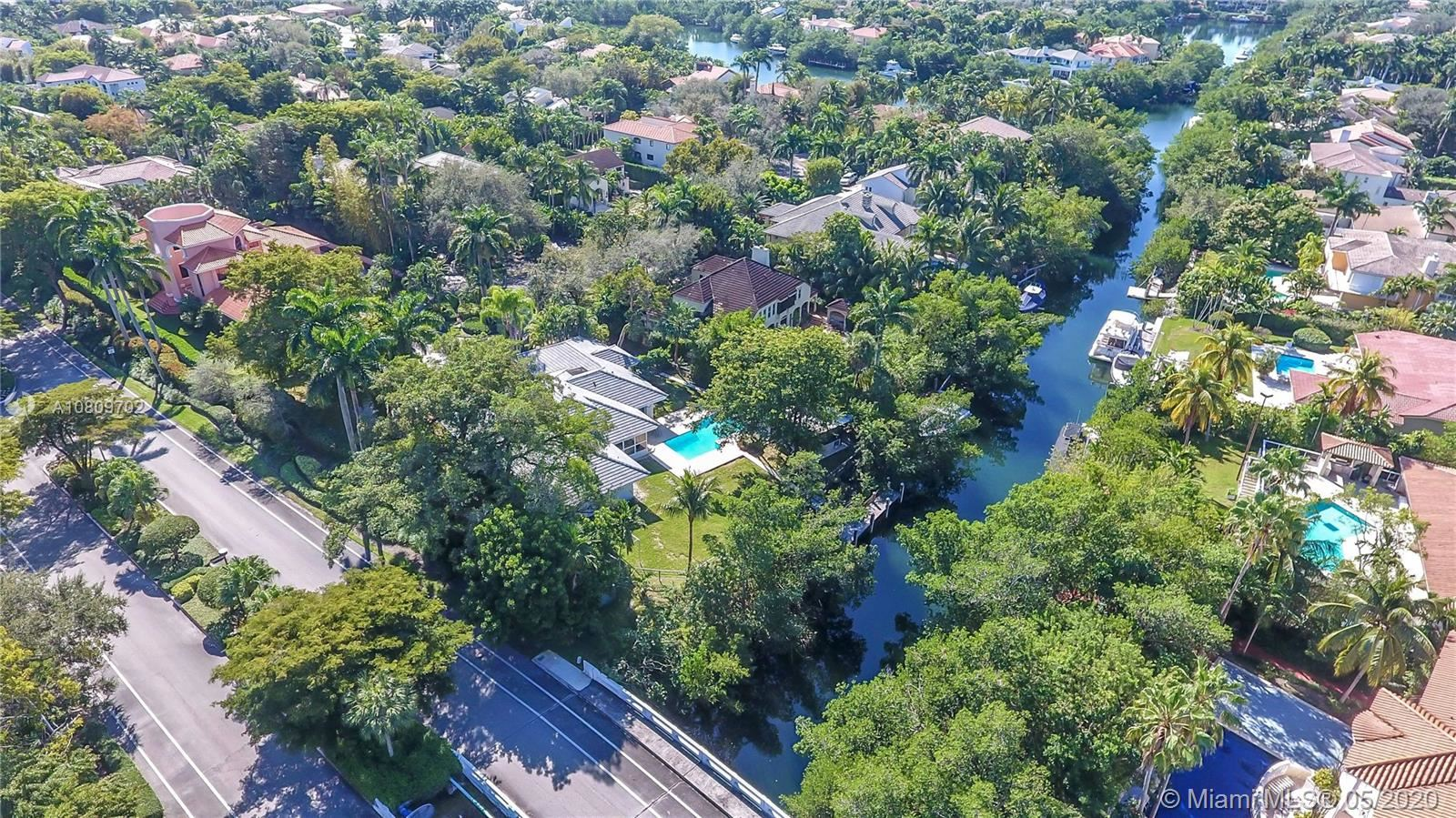 Photo of 7100 W Lago Dr, Coral Gables, FL 33143 (MLS # A10809702)