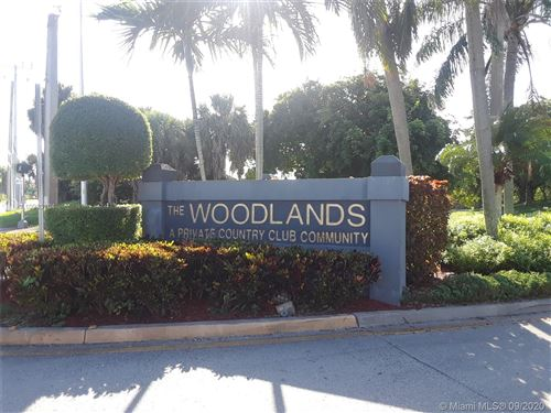 Photo of 4901 N Travelers Palm Ln, Tamarac, FL 33319 (MLS # A10933704)