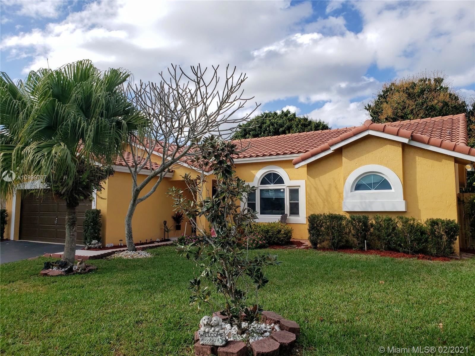 Photo of 9863 NW 28th St, Coral Springs, FL 33065 (MLS # A10999707)